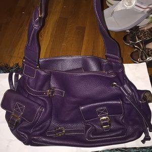 Very cute plum color MAXX N.Y purse!
